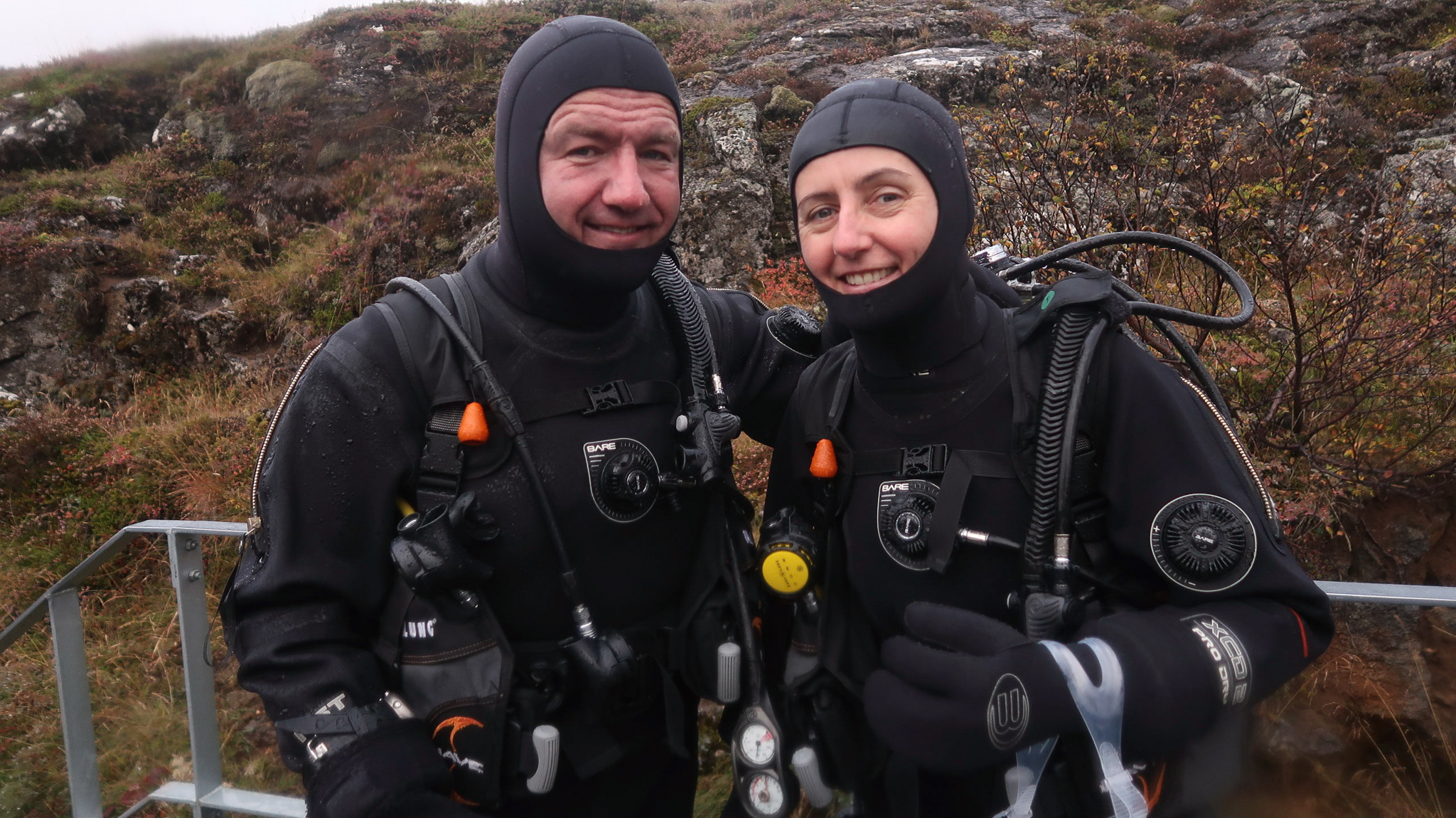Des & Belinda kitted up and ready to dive at Silfra Fissure in Thingvellir National Park, Iceland. Photo by Tania Roque of DIVE.IS