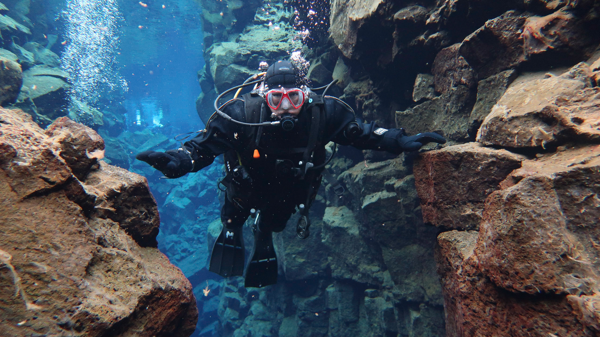 Europe on one side, North America the other while scuba diving at Silfra Fissure in Thingvellir National Park, Iceland. Photo by Tania Roque of DIVE.IS