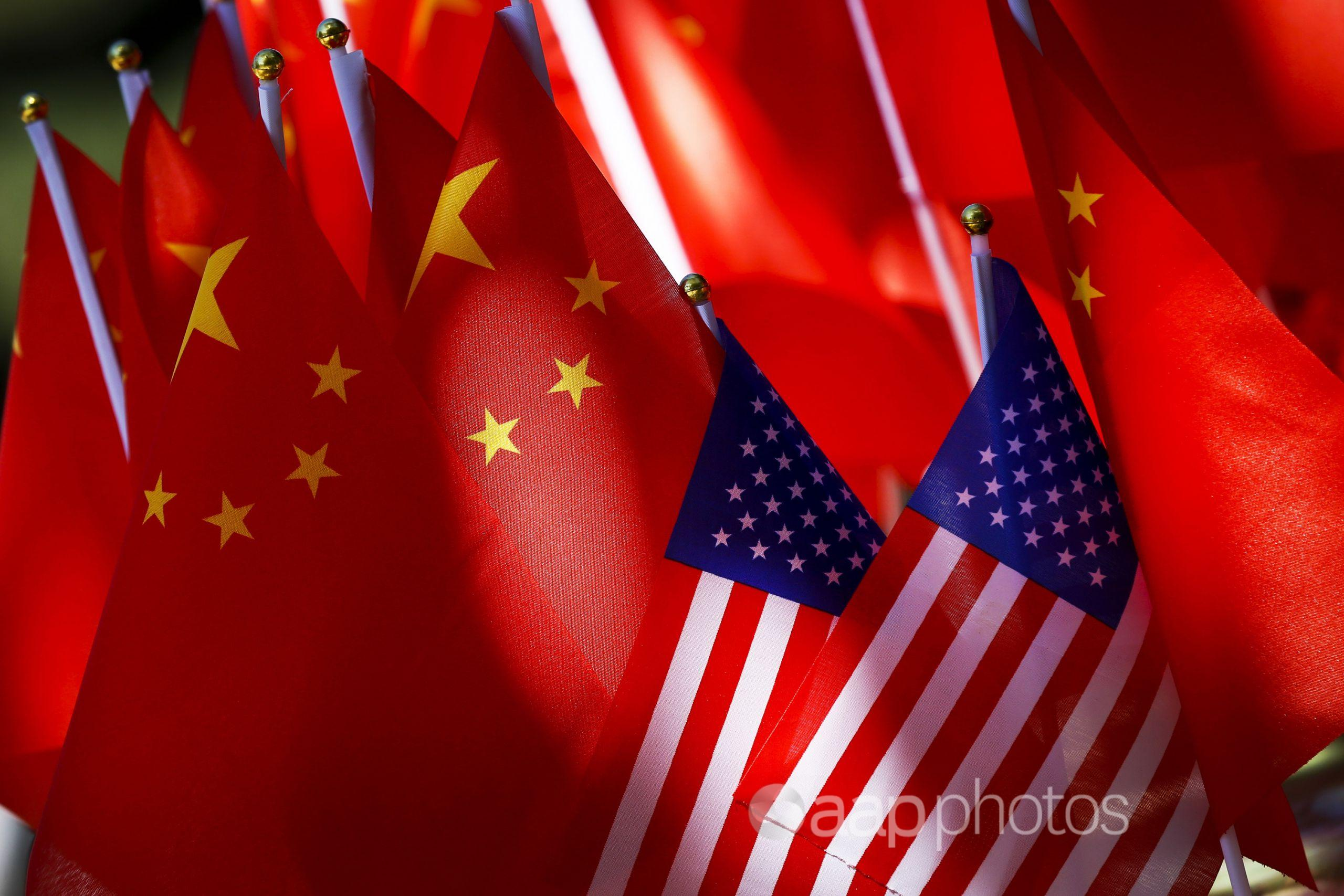 American flags are displayed together with Chinese flags in Beijing