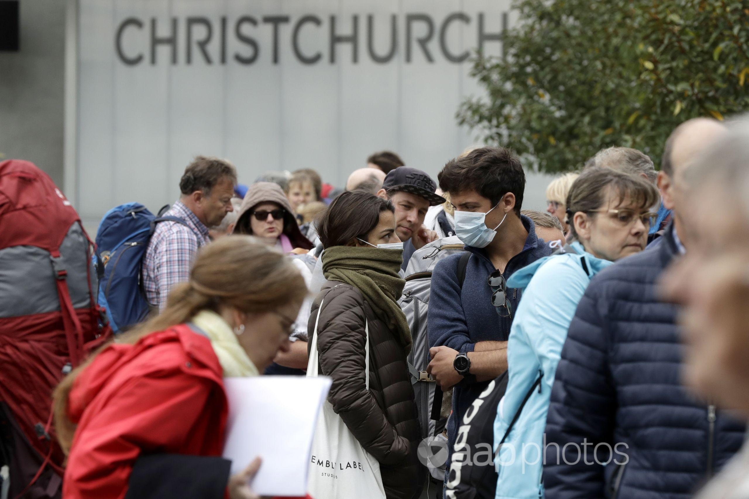 People line-up outside Christchurch Airport.