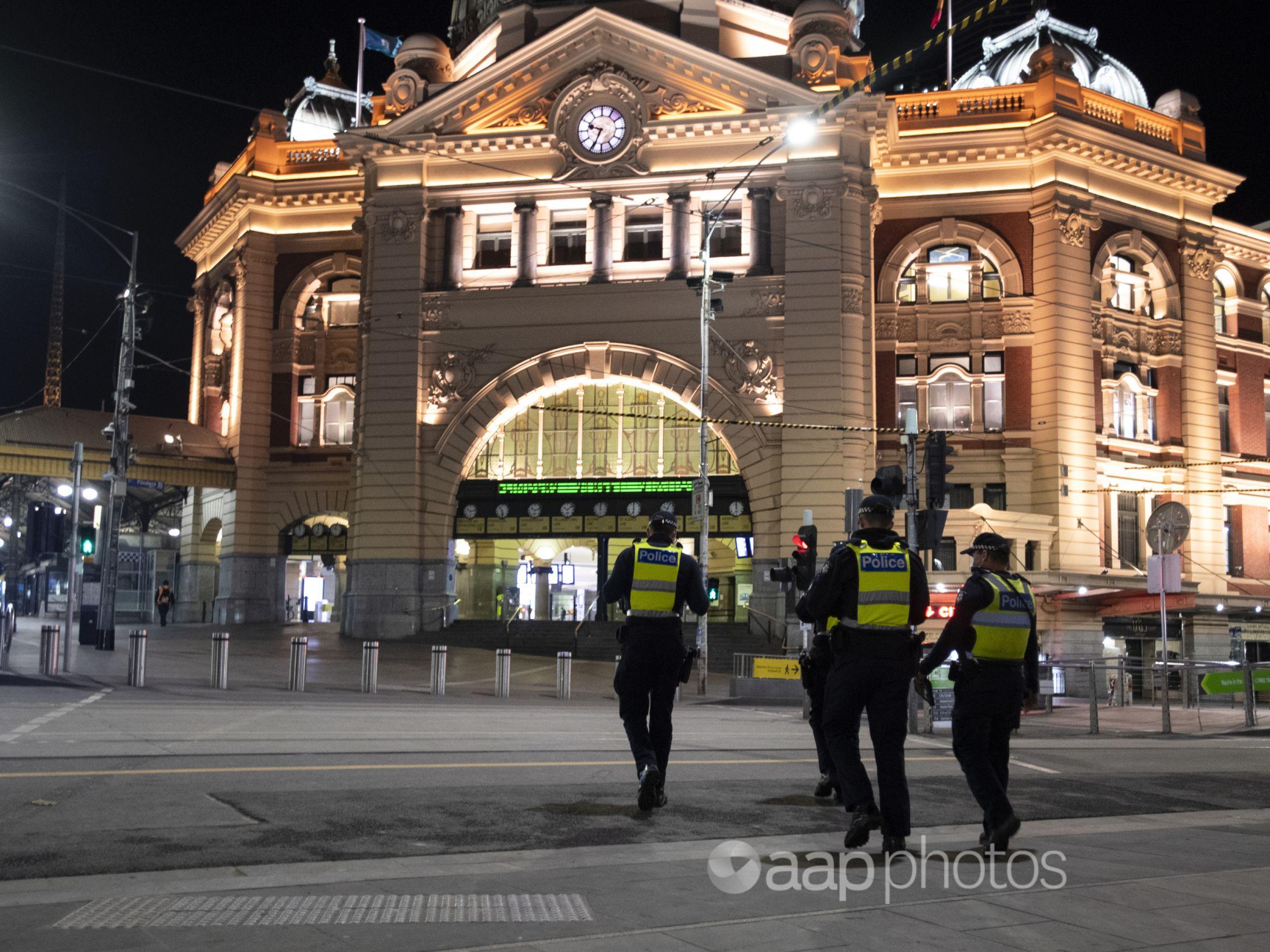 Police patrol Melbourne's Flinders Street station.