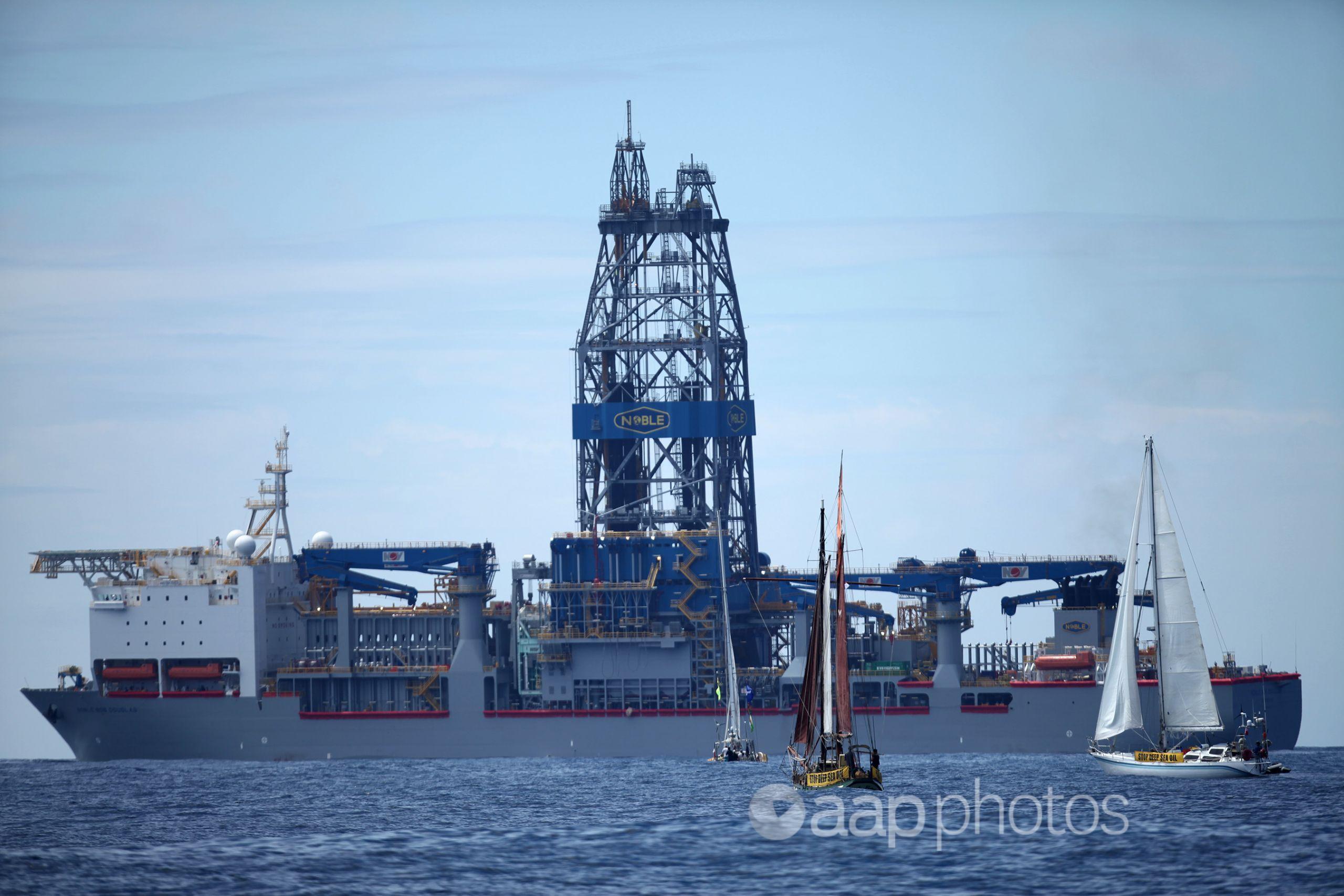 Protest yachts confront the Noble Bob Douglas drilling ship