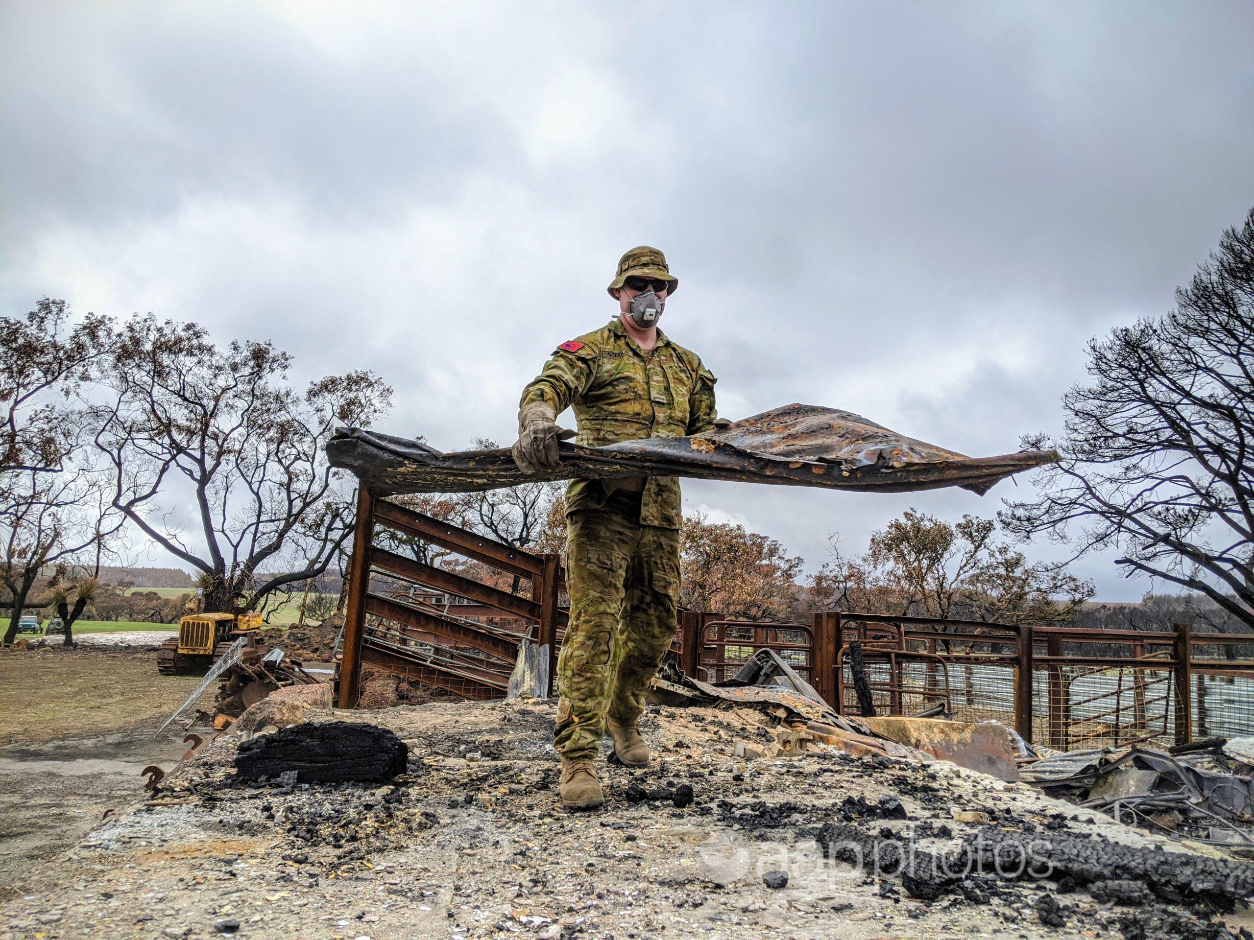 An soldier assisting with a clean-up after fires on Kangaroo Island.