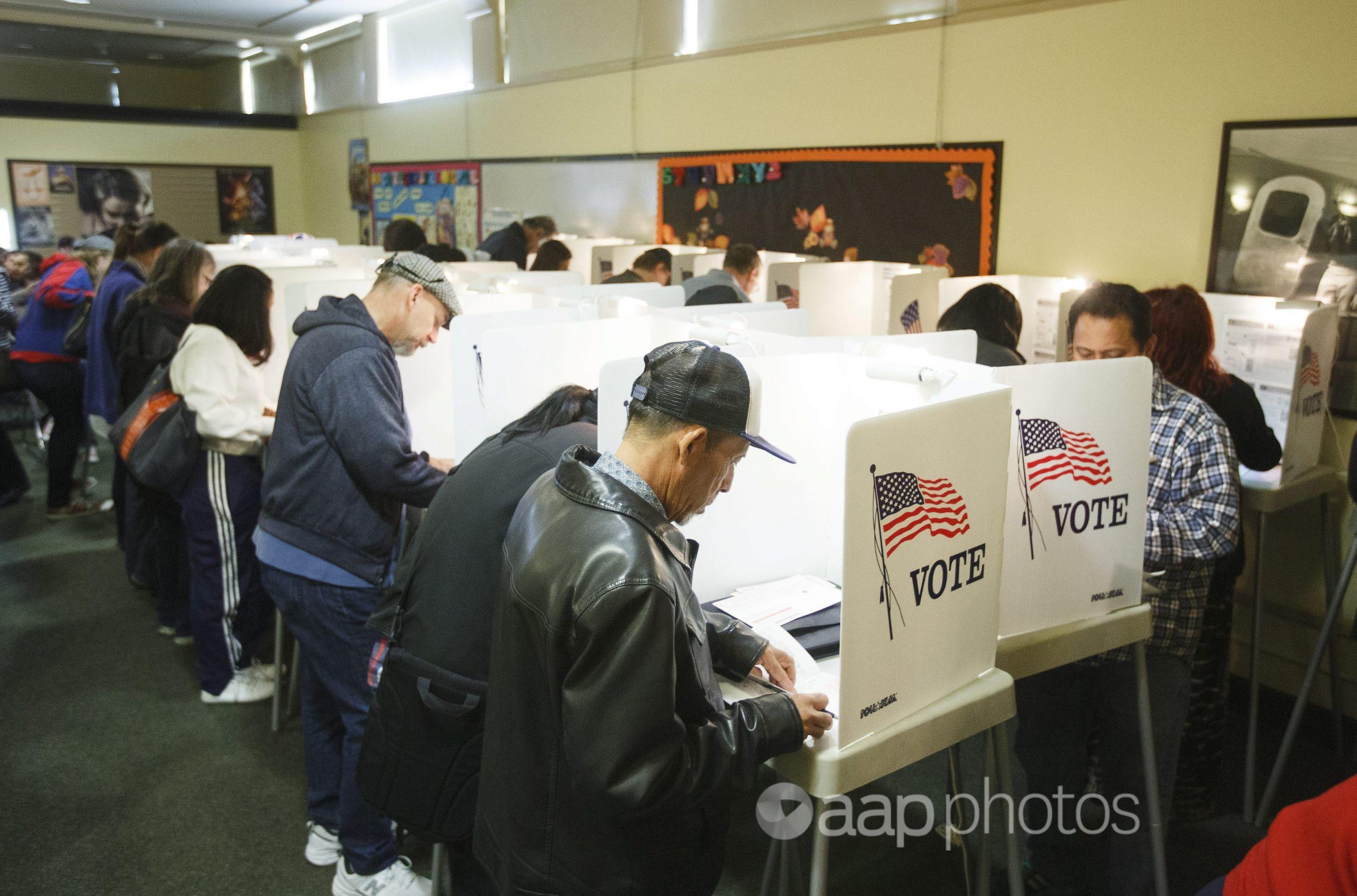 Voters cast their US Presidential ballots
