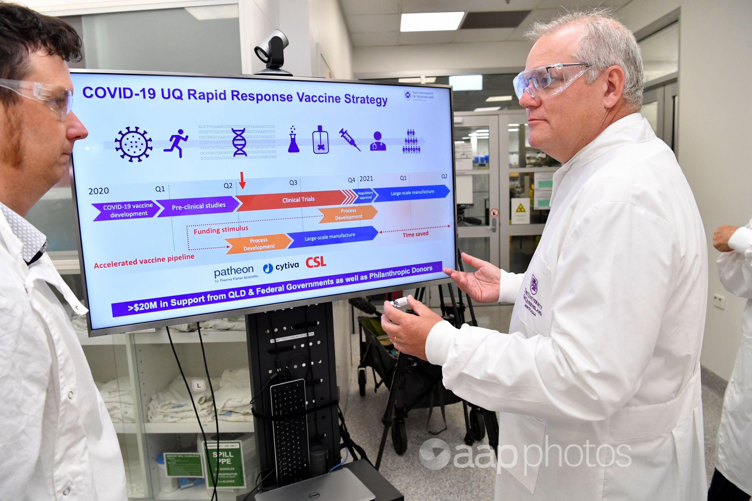 Prime Minister Scott Morrison touring the UQ's lab.