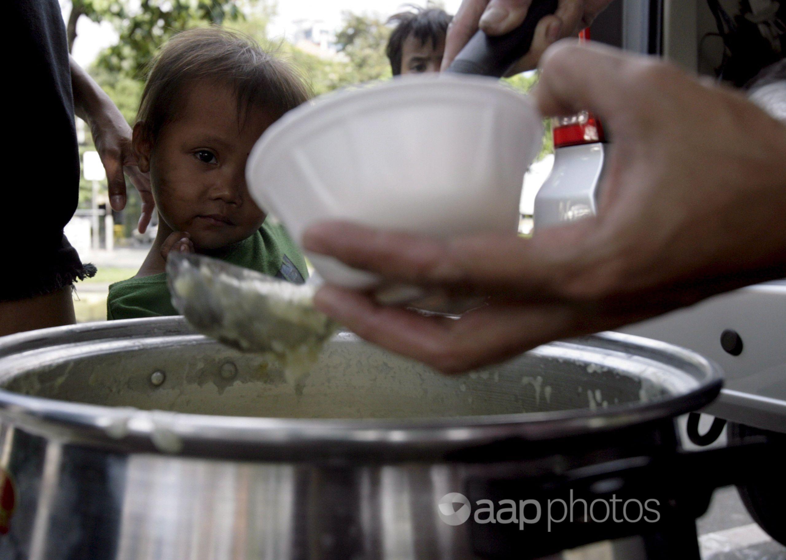 A child receives free porridge