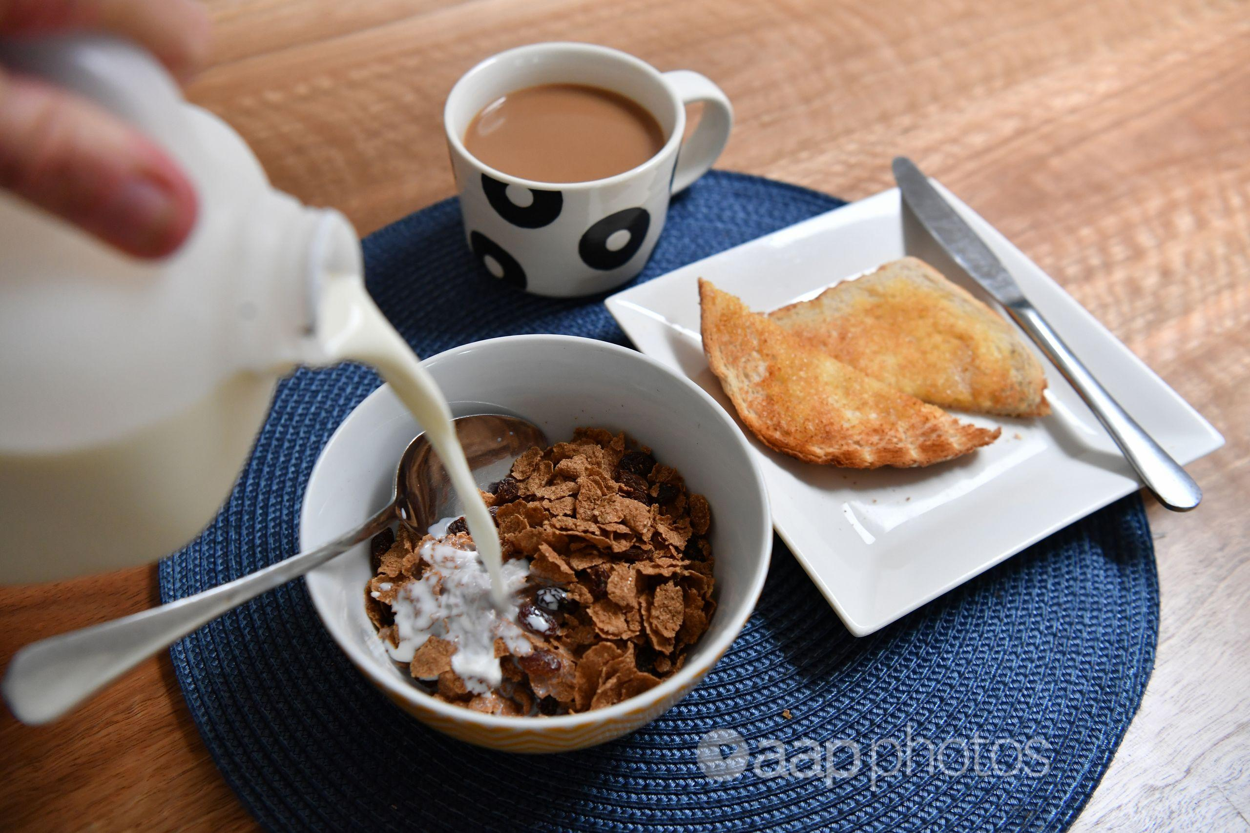 A breakfast of cereal, toast and coffee.