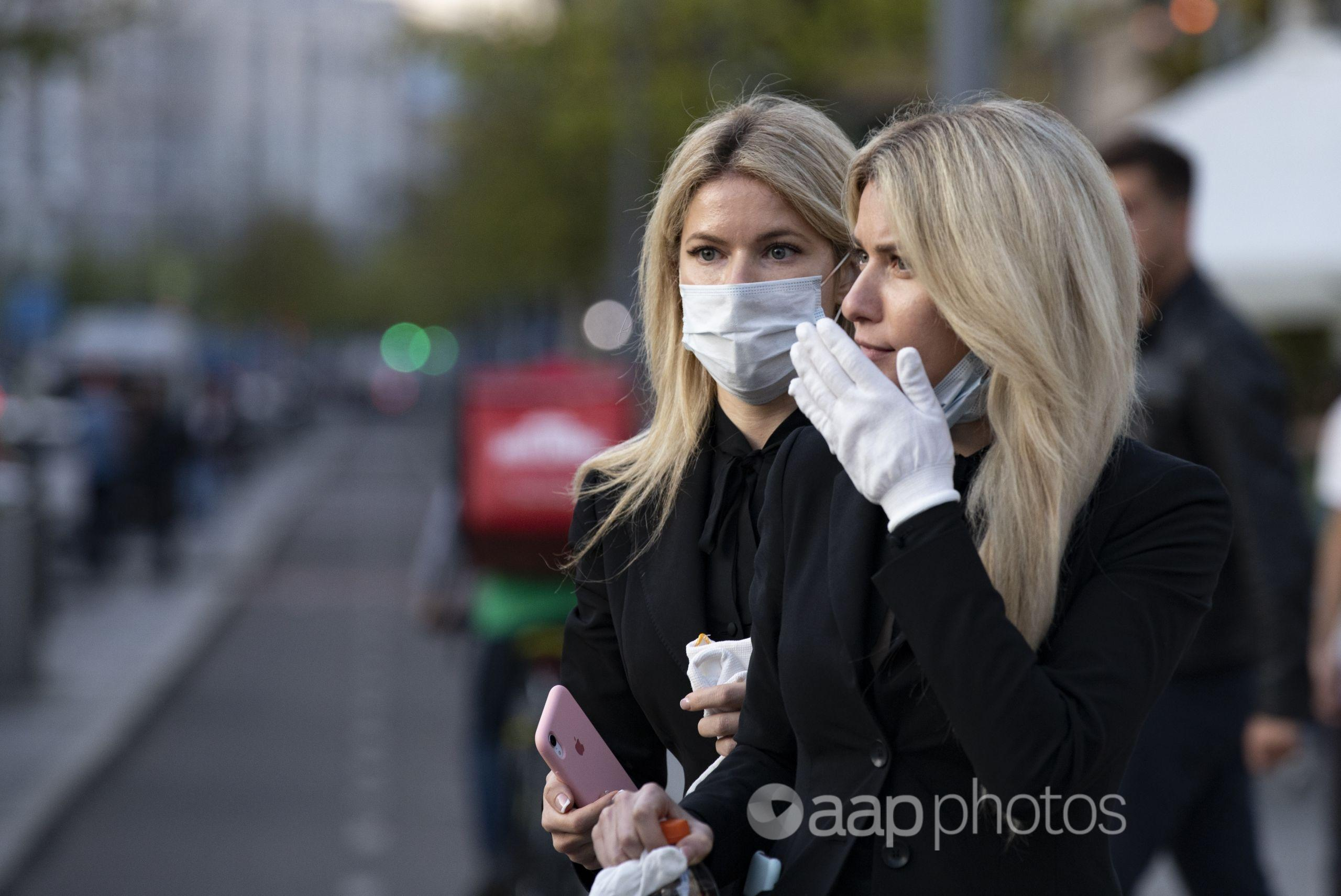 Two women wearing face masks against coronavirus
