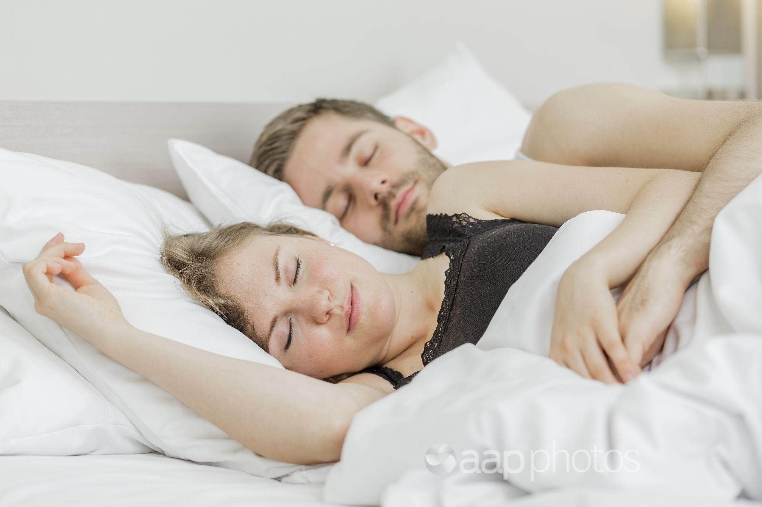 A couple sleeping.