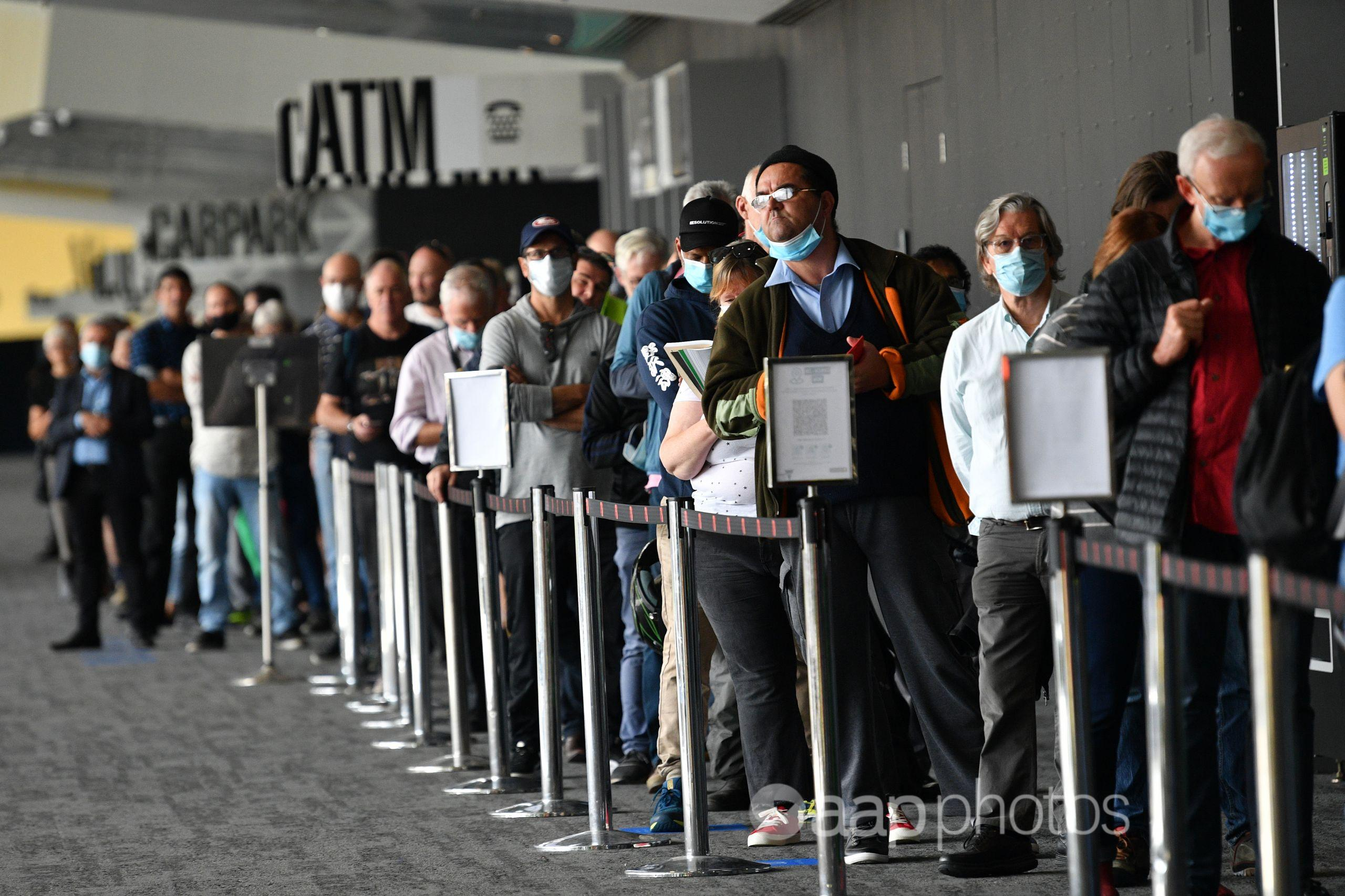 People waiting in a line for vaccination at the Melbourne