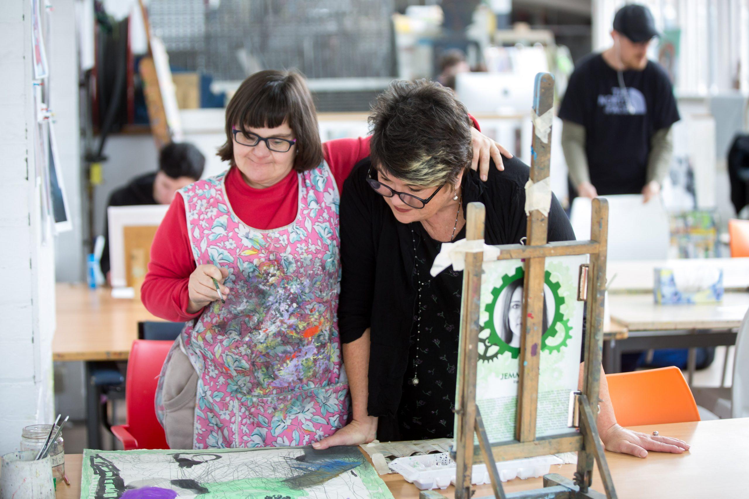 Sue Roff in studio with artist