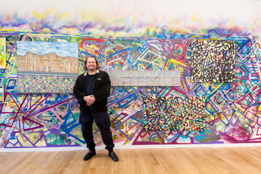 James MacSporran in front of his wall commission
