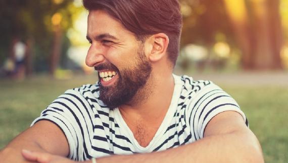 Header_man_smiling_stripes