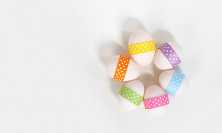 Six small white Easter eggs with colourful polka dot bands