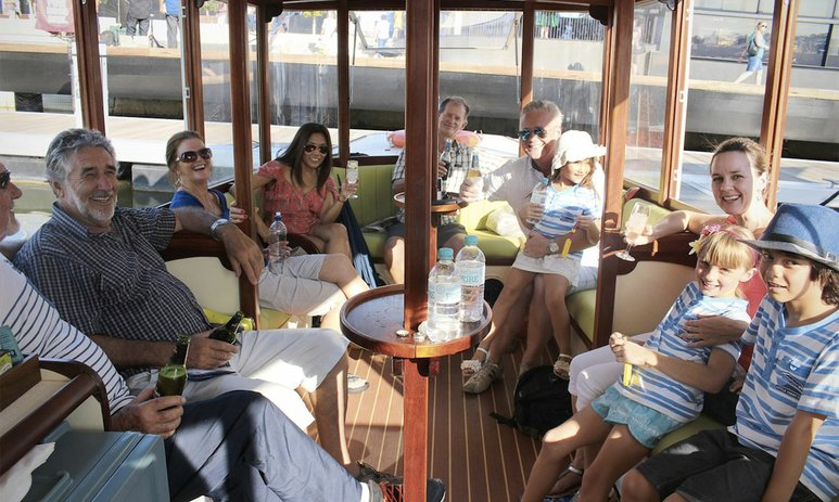 Group of people enjoying Swan River cruise in an electric ferry