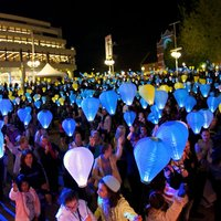 Crowd of people holding lanterns for the Leukaemia Foundations Light the Night event in the James Street Amphitheatre of the Perth Cultural Centre.