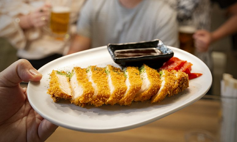 a plate with chicken katsu