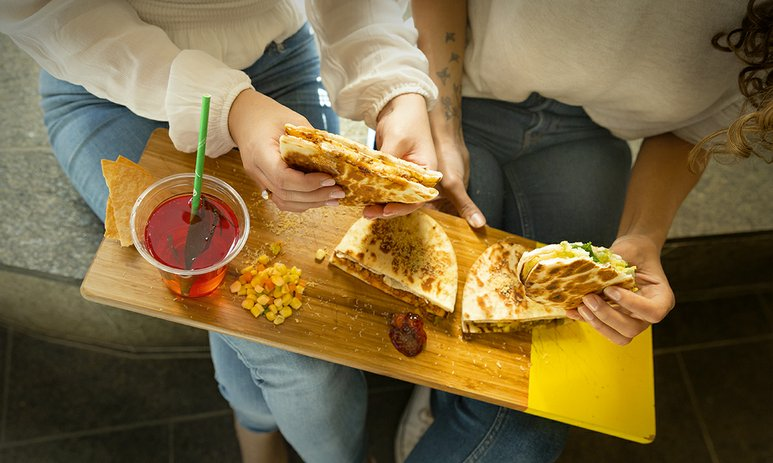 toasted curry sandwiches on a board