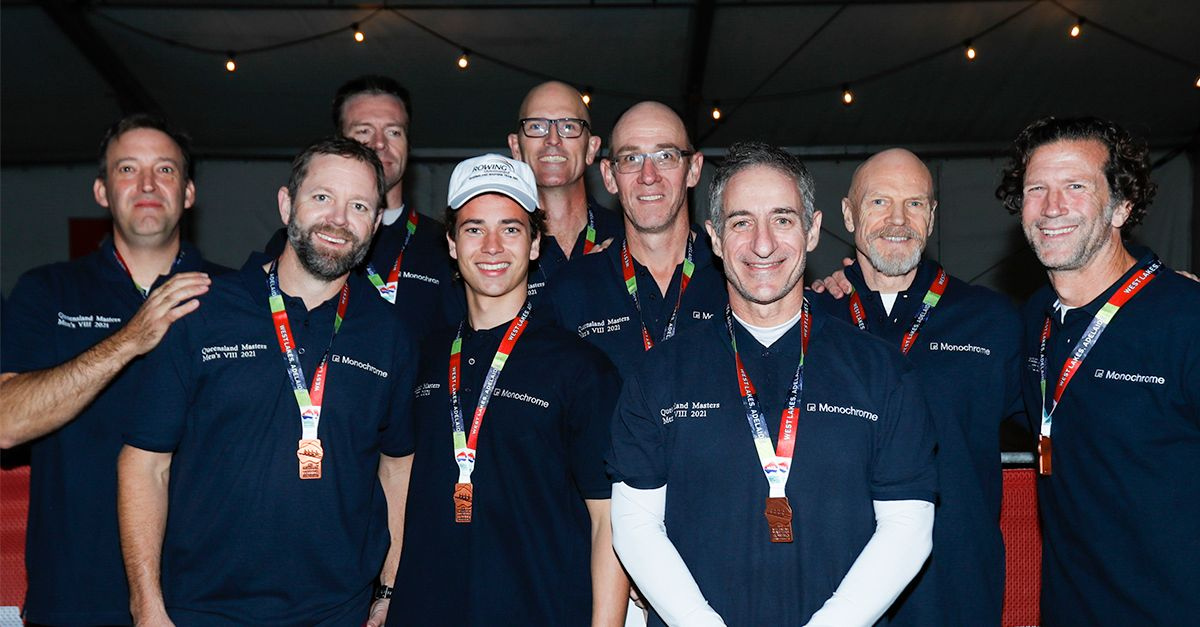 Queensland_Masters_Men's_Eight_Rowing_Team_posing_with_their_medals.jpg