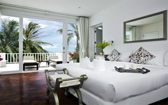 One of the five bedrooms at Villa M, Koh Samui, showing the beatuiful views of the ocean that can be seen from the balcony.
