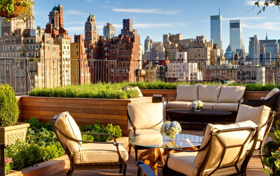 A picture of the rooftop bar and restaurant and its view of New York City at The Surrey, New York, USA