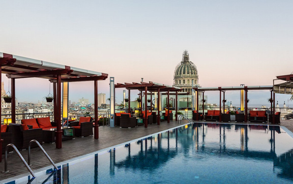 The rooftop pool, restaurants and stunning view at Saratoga, Cuba.
