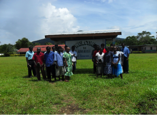 An old picture of Buruku Primary and High school.  Standing are staff and newly baptised students.