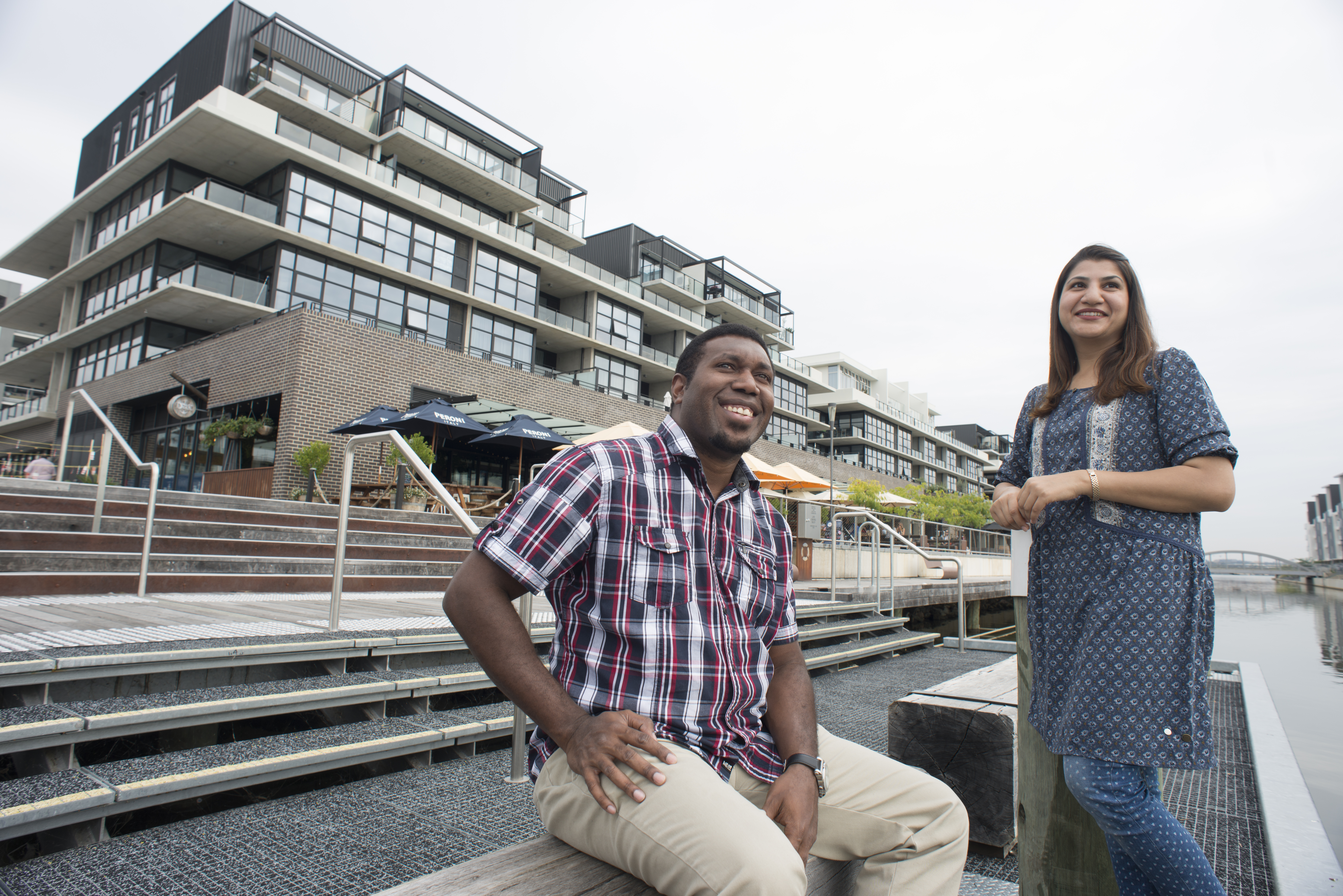 Image of two people at the Kingston foreshore.