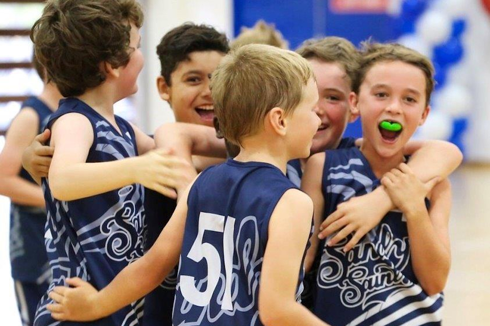 Group of young boys playing basketball