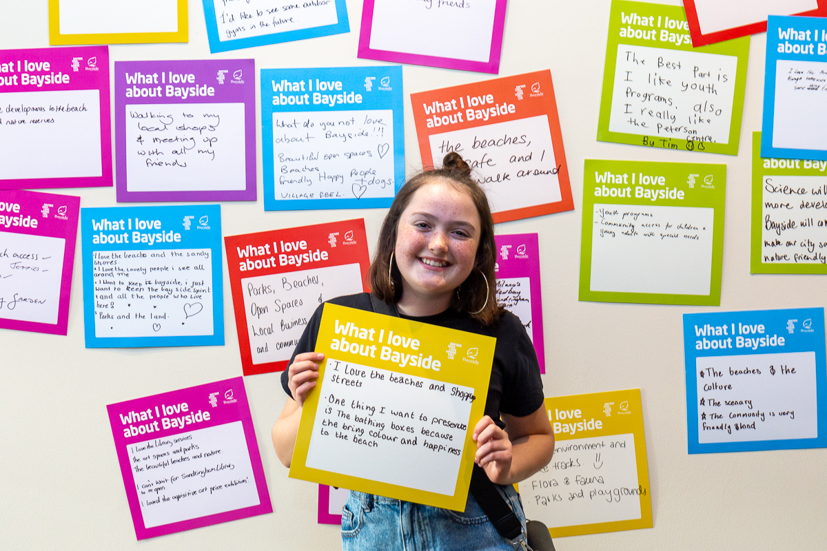 young female with big ideas card