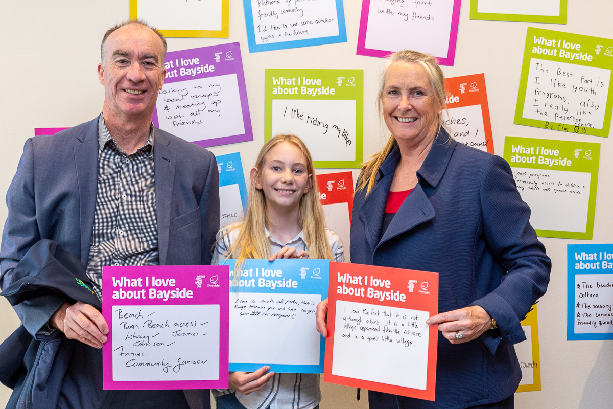 family of three with big ideas card