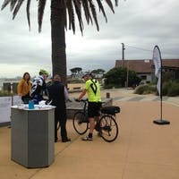 Steve Carson, Council's Transport Planner, showing concept design to cyclists.