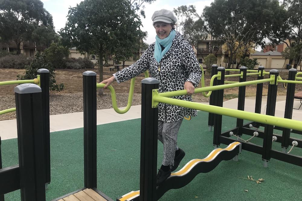 Woman using playground equipment