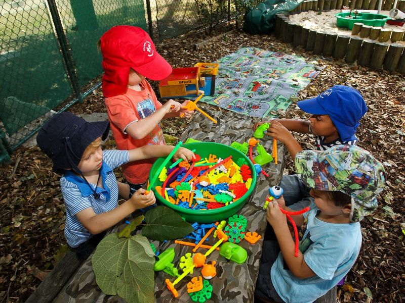 Playgroups image - children playing with plastic connecting rods
