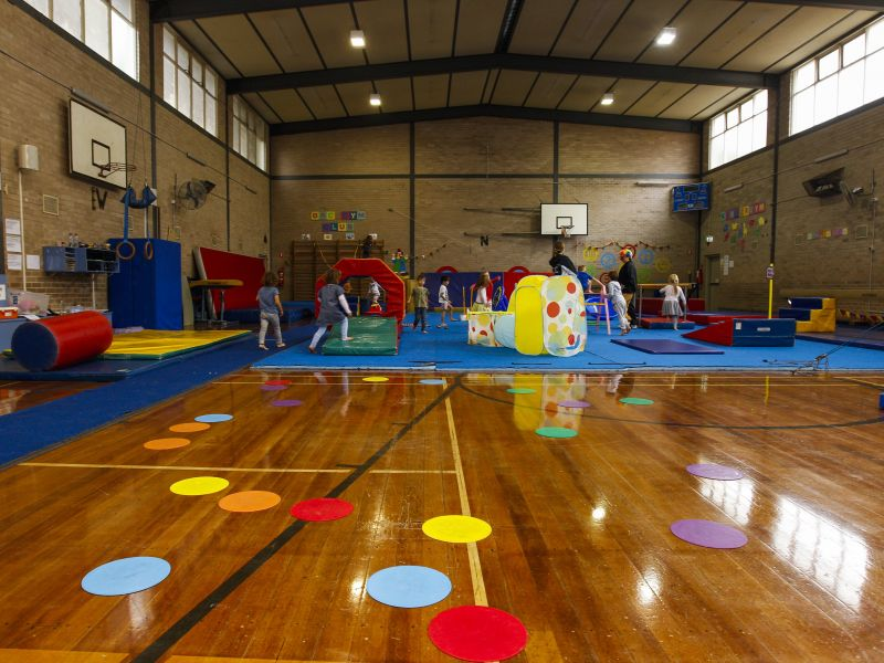 Brighton rec centre - interior - children playing on colourful soft gym equipment
