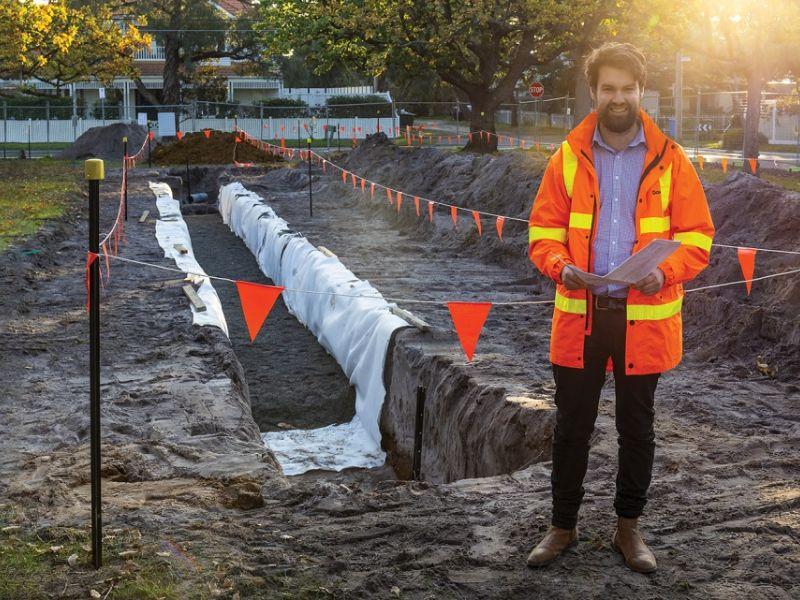 Man constructing drain