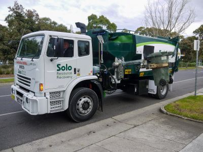 Picture of garbage truck picking up bin