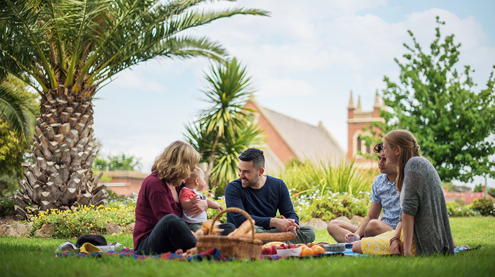 Friends having a picnic in the gardens