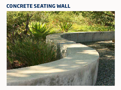 Curved low wide concrete retaining wall with around a garden bed.