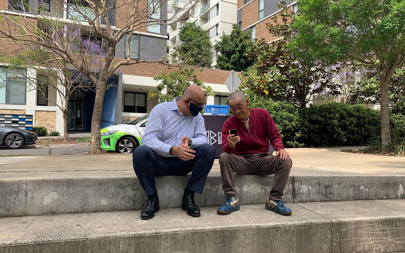 Mayor talking to resident