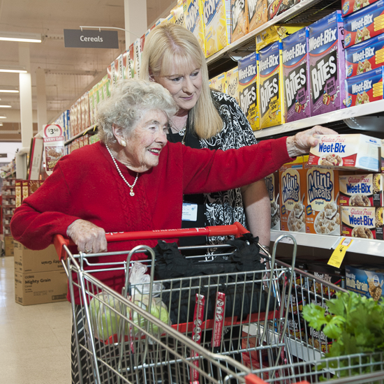 Lady being assisted with her shopping