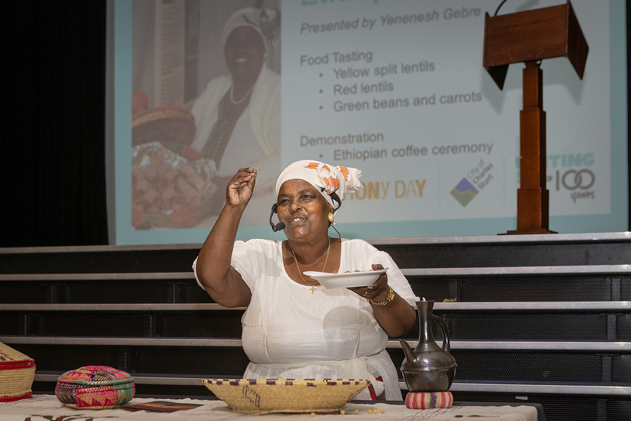 Women demonstrating cooking - an important way of celebrating our multi-cultural community