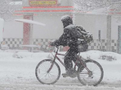 A person biking in the snow