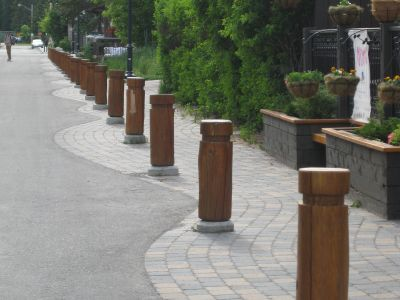metal pillars and patterned sidewalks to calm traffic