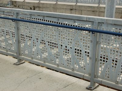 Punched metal railing