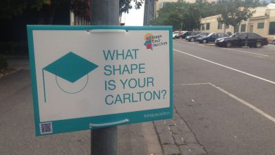 Post with sign attached reading 'What shape is your Carlton?'