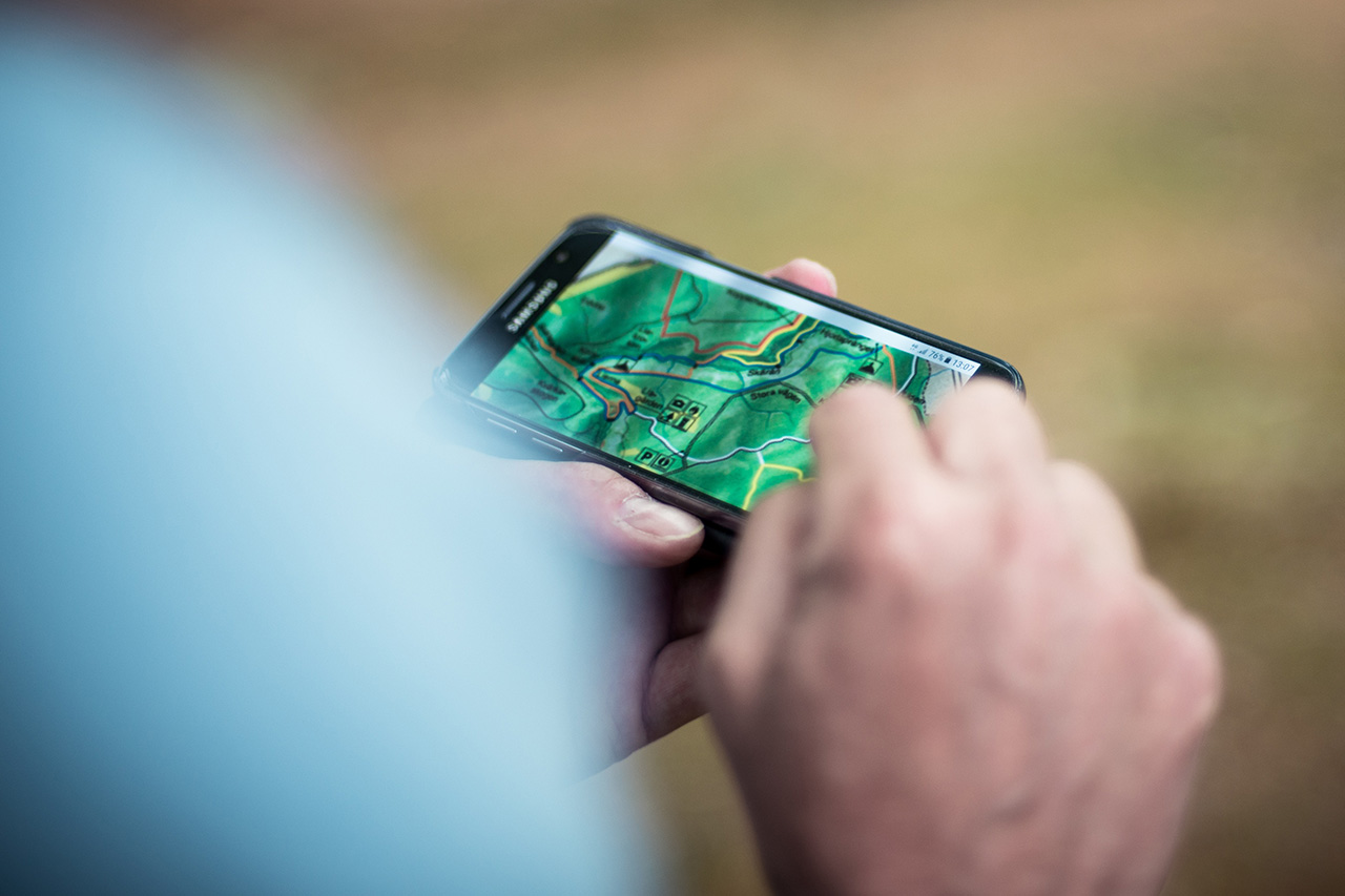 Close up of person using a map on a phone
