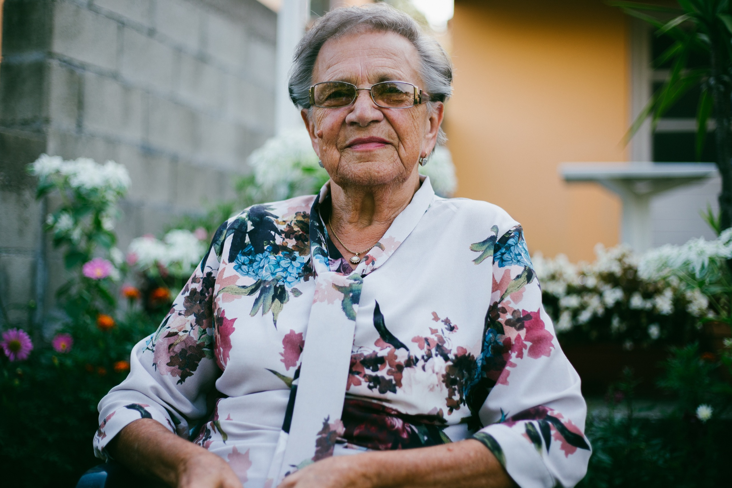 old lady in flowery shirt