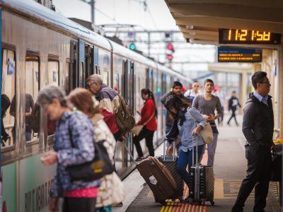 Passengers getting on train
