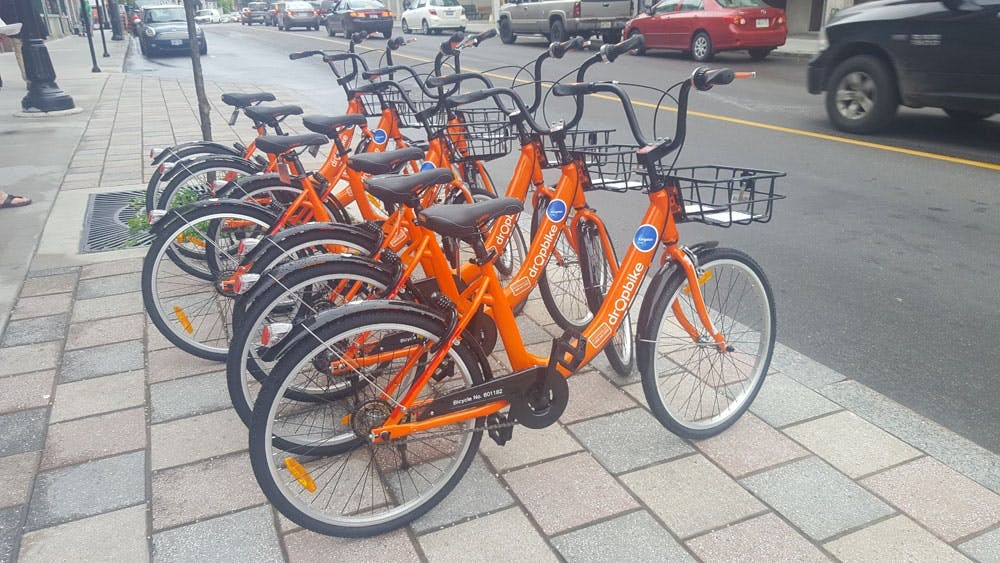 row of orange bikes